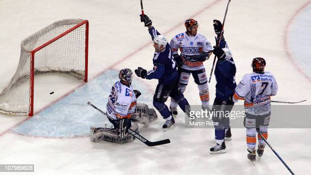 Jason King of Hamburg celebrate with his team mates Colin Murphy the opening goal during the DEL match between Hamburg Freezers and Iserlohn Roosters...