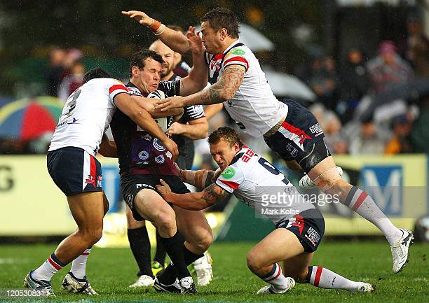 Jason King of the Sea Eagles is hit in a big tackle during the round 22 NRL match between the Manly Warringah Sea Eagles and the Sydney Roosters at...