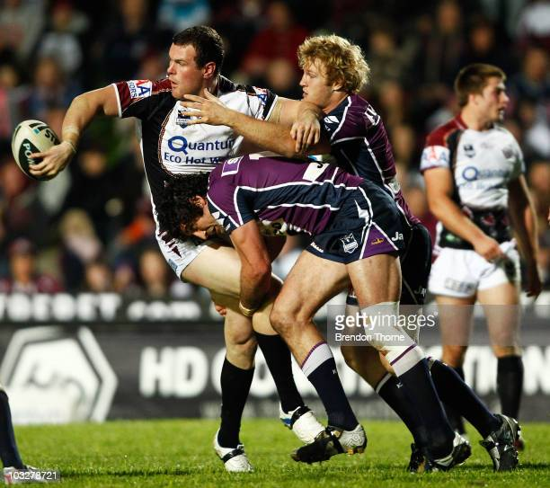Jason King of the Sea Eagles off loads the ball during the round 22 NRL match between the Manly Sea Eagles and the Melbourne Storm at Brookvale Oval...