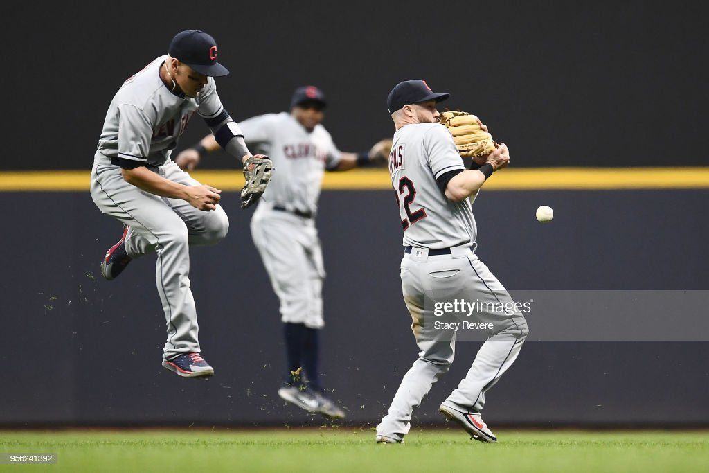 Jason Kipnis #22 and Brandon Guyer #6 of the Cleveland Indians collide during the fourth inning of a game against the Milwaukee Brewers at Miller Park on May 8, 2018 in Milwaukee, Wisconsin.