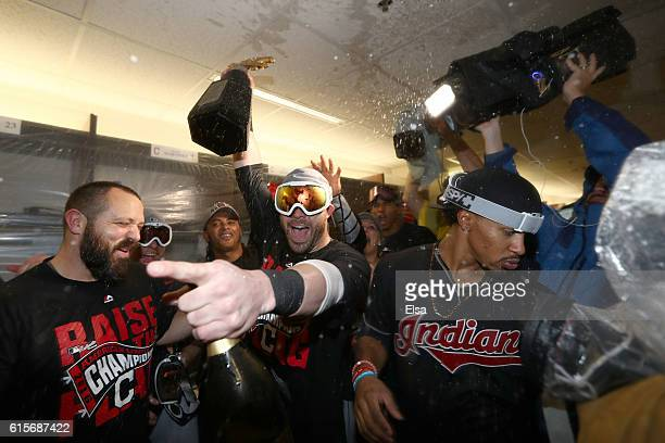 Jason Kipnis and Francisco Lindor of the Cleveland Indians celebrate with his teammates in the locker room after defeating the Toronto Blue Jays with...