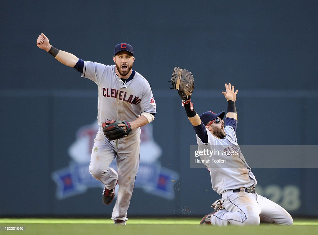 Jason Kipnis #22 and Nick Swisher #33 of the Cleveland Indians celebrates a win against the Minnesota Twins on September 29, 2013 at Target Field in Minneapolis, Minnesota. The Indians defeated the Twins 5-1 and clinched a American League Wild Card berth.