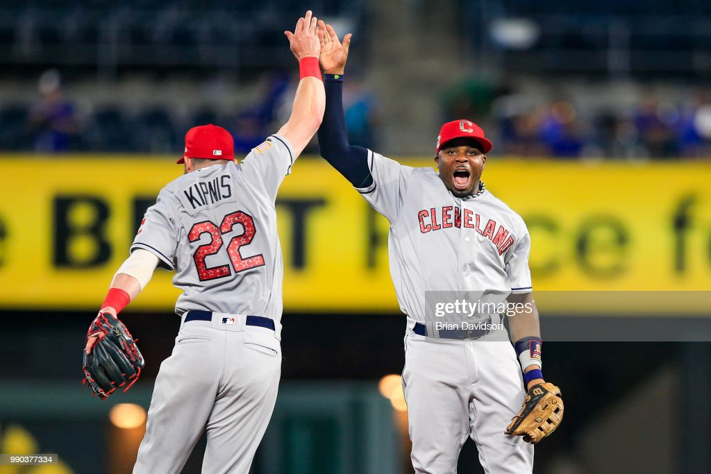 Jason Kipnis #22 and Rajai Davis #26 of the Cleveland Indians celebrate their win over the Kansas City Royals after the game at Kauffman Stadium on July 2, 2018 in Kansas City, Missouri.