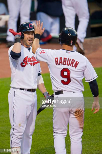 Jason Kipnis and Ryan Raburn of the Cleveland Indians celebrate after scoring during the fourth inning against the Cincinnati Reds at Progressive...