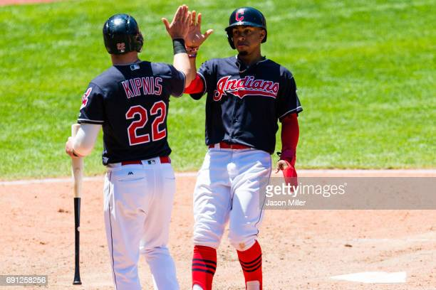 Jason Kipnis celebrates with Francisco Lindor of the Cleveland Indians after both scored on a single by Michael Brantley seventh inning against the...