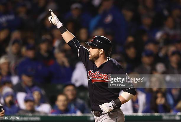 Jason Kipnis of the Cleveland Indians celebrates after hitting a home run in the seventh inning against the Chicago Cubs in Game Four of the 2016...