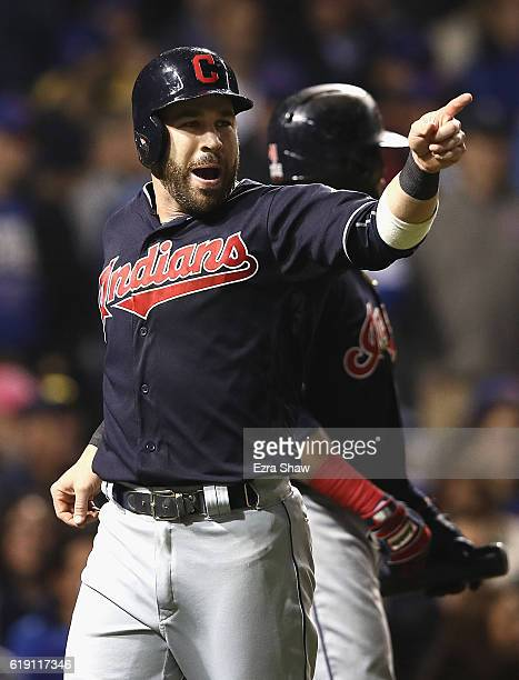 Jason Kipnis of the Cleveland Indians celebrates after scoring a run in the third inning against the Chicago Cubs in Game Four of the 2016 World...