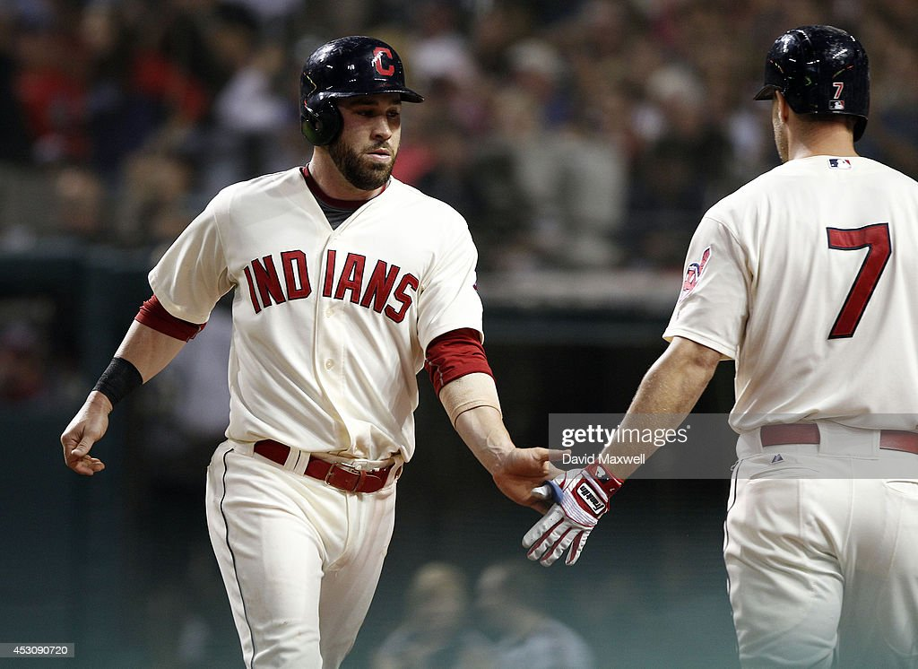Jason Kipnis #22 of the Cleveland Indians celebrates with David Murphy #7 after scoring on a single by Lonnie Chisenhall #8 (not pictured) against the Texas Rangers during the sixth inning of their game on August 2, 2014 at Progressive Field in Cleveland, Ohio.