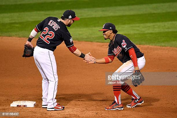 Jason Kipnis of the Cleveland Indians celebrates with Francisco Lindor after defeating the Chicago Cubs 60 in Game One of the 2016 World Series at...