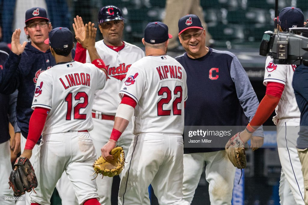 Jason Kipnis #22 of the Cleveland Indians celebrates with manager manager Terry Francona #77 after the Indians defeated the Toronto Blue Jays in game two of a doubleheader at Progressive Field on May 3, 2018 in Cleveland, Ohio. The Indians defeated the Blue Jays 13-4.