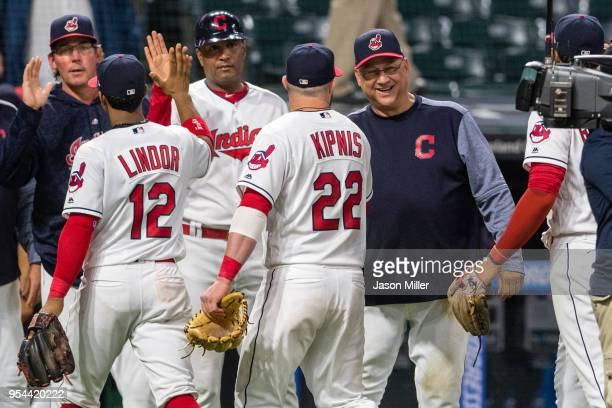 Jason Kipnis of the Cleveland Indians celebrates with manager manager Terry Francona after the Indians defeated the Toronto Blue Jays in game two of...