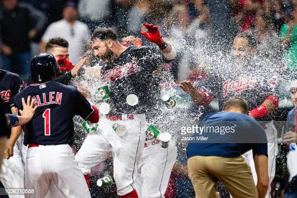Jason Kipnis of the Cleveland Indians celebrates with teammates after hitting a walkoff grand slam during the ninth inning against the Chicago White...