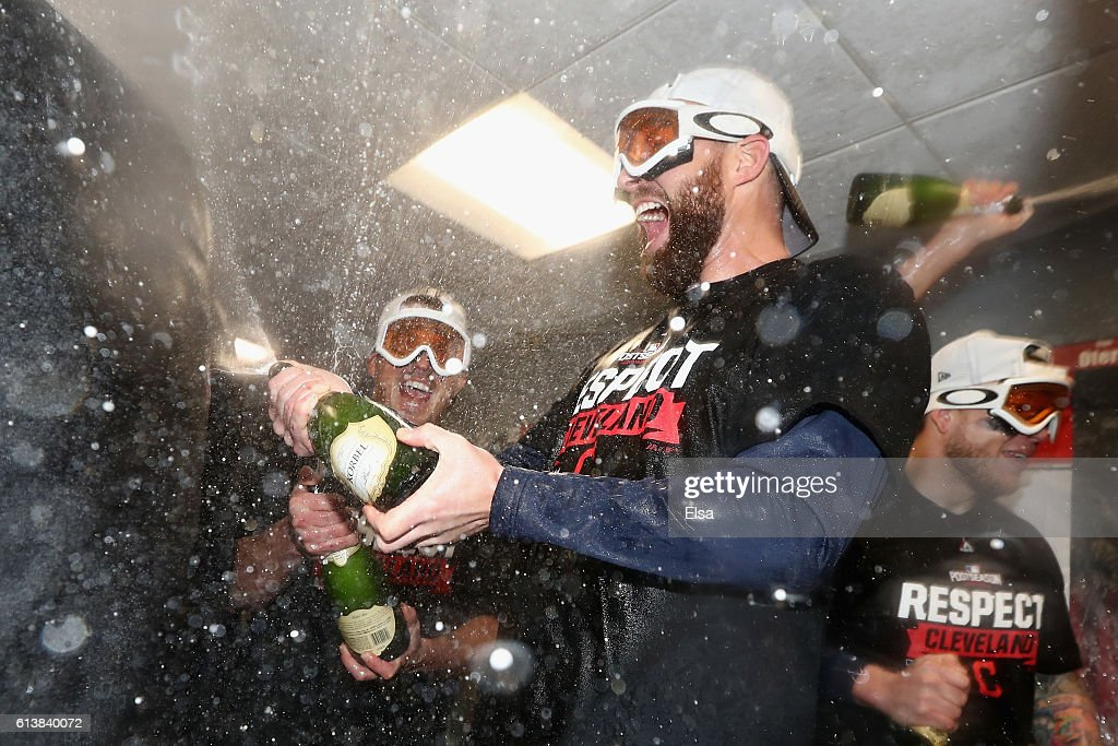 Jason Kipnis #22 of the Cleveland Indians celebrates with teammates in the clubhouse after defeating the Boston Red Sox 4-3 in game three of the American League Divison Series to advance to the American League Championship Series at Fenway Park on October 10, 2016 in Boston, Massachusetts.
