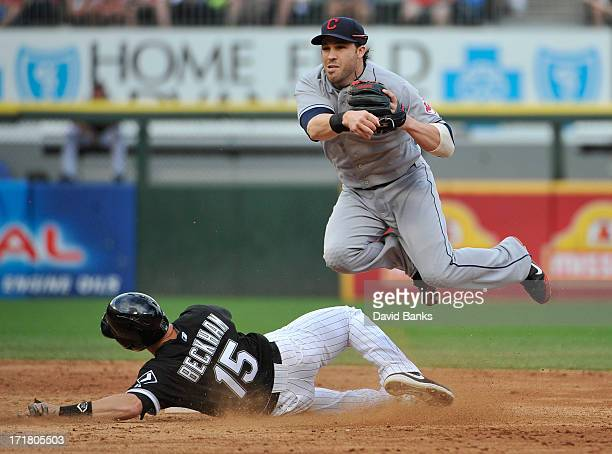 Jason Kipnis of the Cleveland Indians forces out Gordon Beckham of the Chicago White Sox during the third inning in the first game of a doubleheader...
