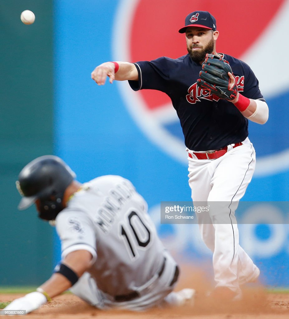 Jason Kipnis #22 of the Cleveland Indians forces out Yoan Moncada #10 of the Chicago White Sox at second base and throws out Yolmer Sanchez at first base to complete the double play during the eighth inning at Progressive Field on May 29, 2018 in Cleveland, Ohio. The Indians defeated the White Sox 7-3.