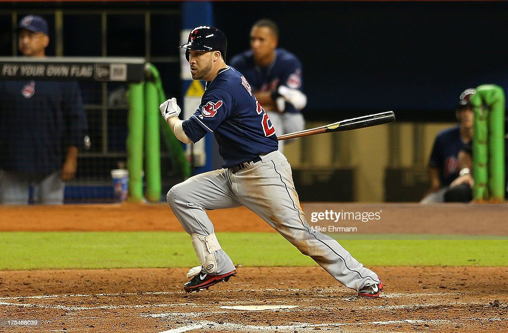 Jason Kipnis #22 of the Cleveland Indians hits a two RBI single during a game against the Miami Marlins at Marlins Park on August 3, 2013 in Miami, Florida.