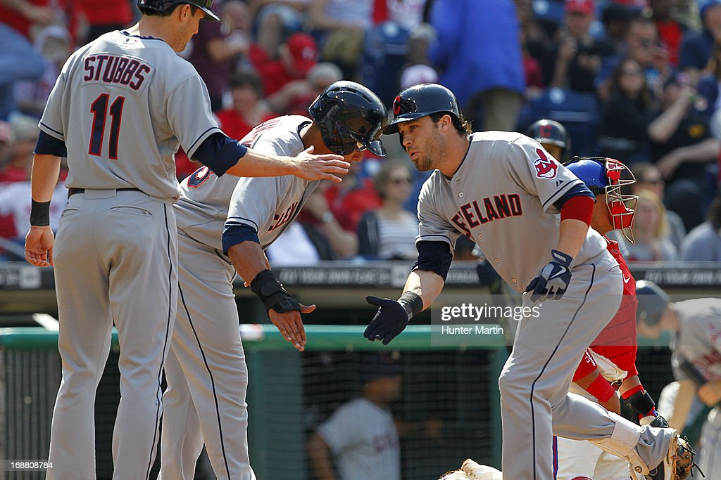 Jason Kipnis #22 of the Cleveland Indians is congratulated at home plate after hitting a three run home run in the eighth inning during a game against the Philadelphia Phillies at Citizens Bank Park on May 15, 2013 in Philadelphia, Pennsylvania. The Indians won 10-4.