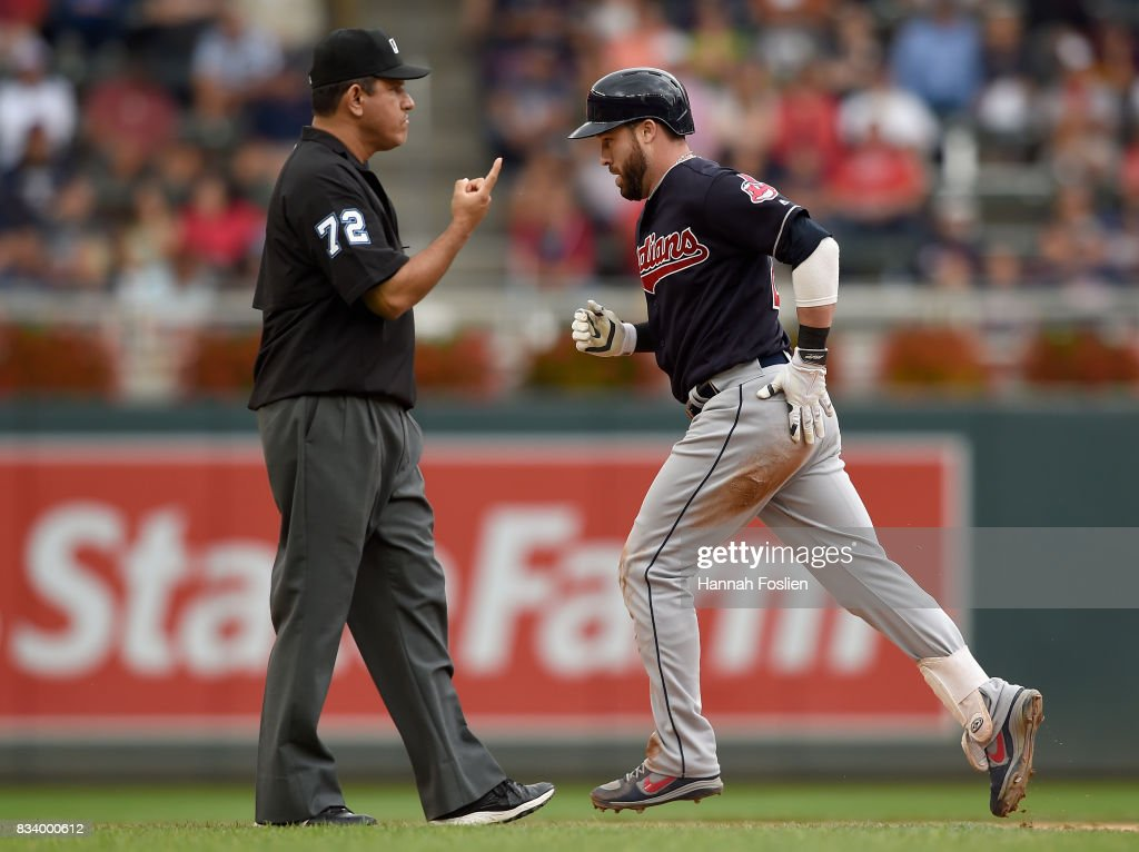 Jason Kipnis #22 of the Cleveland Indians rounds the bases after hitting a solo home run as umpire Alfonso Marquez #72 signals during the eighth inning in game one of a doubleheader on August 17, 2017 at Target Field in Minneapolis, Minnesota. The Indians defeated the Twins 9-3.