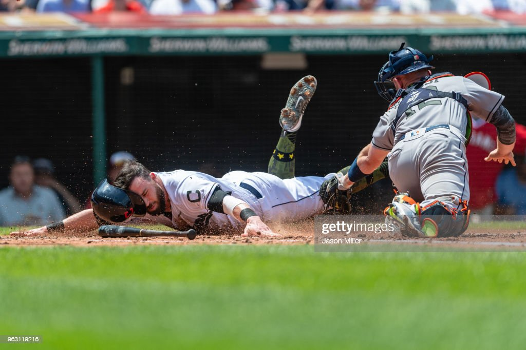 Jason Kipnis #22 of the Cleveland Indians scores on a hit by Jose Ramirez during the second inning as catcher Max Stassi #12 of the Houston Astros tries to make the tag at Progressive Field on May 27, 2018 in Cleveland, Ohio. The Indians defeated the Astros 10-9 in the 14th inning.