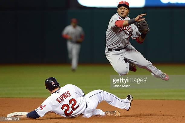 Jason Kipnis of the Cleveland Indians slides into second base as shortstop Erick Aybar of the Los Angeles Angels of Anaheim throws to first for the...