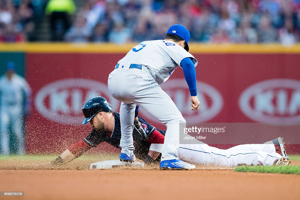 Jason Kipnis #22 of the Cleveland Indians steals second base as second baseman Whit Merrifield #15 of the Kansas City Royals tries to make the tag during the first inning at Progressive Field on September 20, 2016 in Cleveland, Ohio.