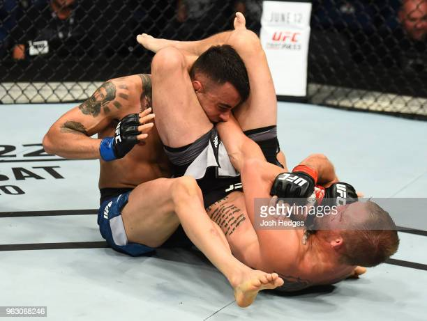 Jason Knight attempts to submit Makwan Amirkhani of Kurdistanin their featherweight bout during the UFC Fight Night event at ECHO Arena on May 27...
