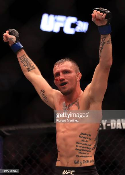 Jason Knight celebrates his victory against Chas Skelly in their Featherweight bout during UFC 211 at American Airlines Center on May 13 2017 in...