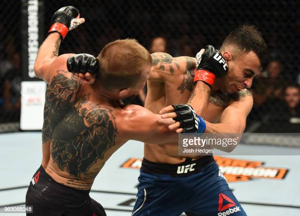 Jason Knight exchanges punches with Makwan Amirkhani of Kurdistan in their featherweight bout during the UFC Fight Night event at ECHO Arena on May...