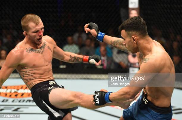 Jason Knight kicks Makwan Amirkhani of Kurdistan in their featherweight bout during the UFC Fight Night event at ECHO Arena on May 27 2018 in...