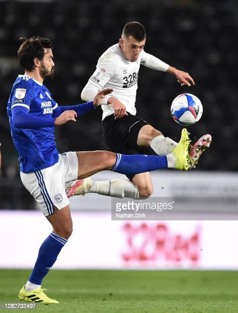 Jason Knight of Derby County and Marlon Pack of Cardiff City compete for the ball during the Sky Bet Championship match between Derby County and...