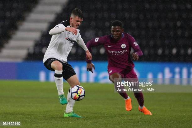 Jason Knight of Derby County and Tom DeleBashiru of Manchester City during the Premier League 2 match between Derby County and Manchester City on...