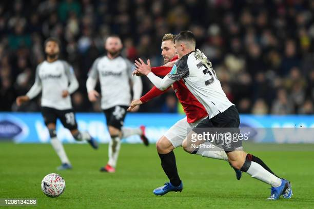 Jason Knight of Derby County battles with Luke Shaw of Manchester United during the FA Cup match between Derby County and Manchester United at the...