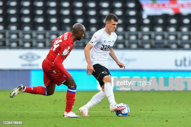 Jason Knight of Derby County with Sone Aluko of Reading looking to make a tackle during the Sky Bet Championship match between Derby County and...