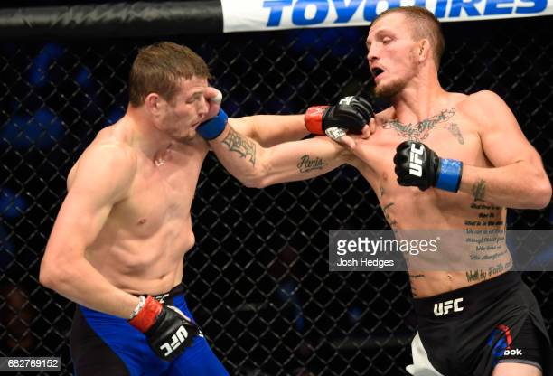 Jason Knight punches Chas Skelly in their featherweight fight during the UFC 211 event at the American Airlines Center on May 13 2017 in Dallas Texas