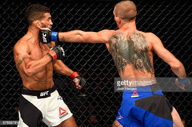 Jason Knight punches Jim Alers in their featherweight bout during the UFC Fight Night event at the United Center on July 23 2016 in Chicago Illinois