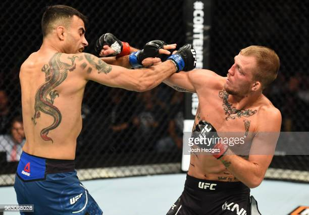 Jason Knight punches Makwan Amirkhani of Kurdistan in their featherweight bout during the UFC Fight Night event at ECHO Arena on May 27 2018 in...
