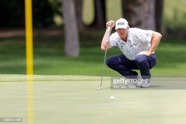 Jason Kokrak lines up his putt on during the first round of the Charles Schwab Challenge on May 27, 2021 at Colonial Country Club in Fort Worth, TX