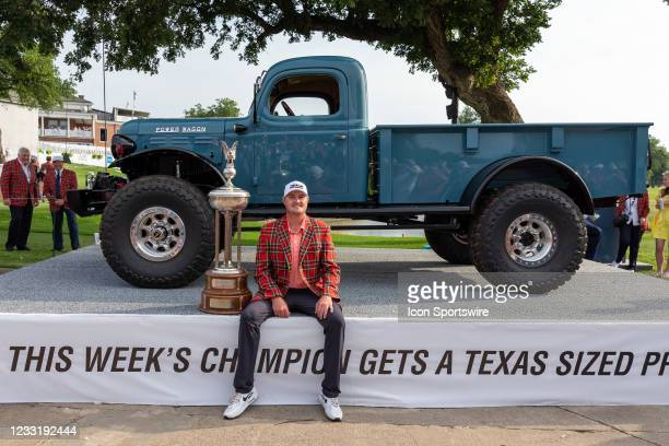 Jason Kokrak poses with trophy and sponsors 75th anniversary truck after winning the Charles Schwab Challenge on May 30, 2021 at Colonial Country...