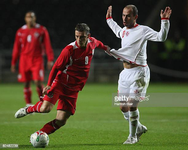 Jason Koumas of Wales contests with Zurab Khizanishvili of Georgia during the International Friendly match between Wales and Georgia at The Liberty...