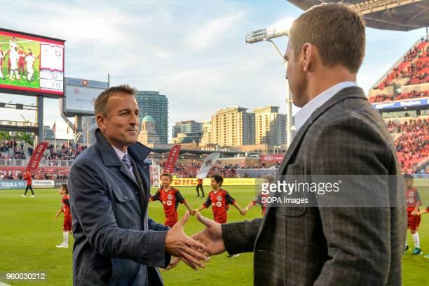 BMO FIELD TORONTO ONTARIO CANADA Jason Kreis greeting with Greg Vanney before the 2018 MLS Regular Season match between Toronto FC and Orlando City...