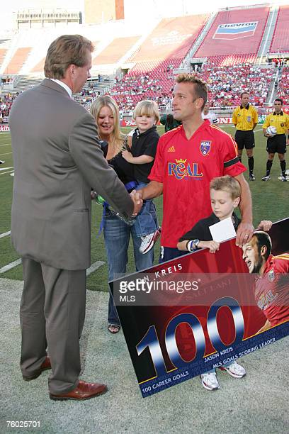 Jason Kreis of Real Salt Lake is congratulated and presented with an engraved watch by team owner Dave Checketts as a keepsake for scoring his 100th...