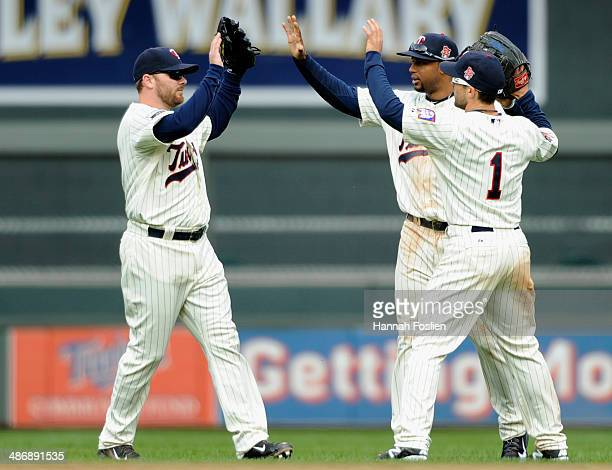 Jason Kubel Aaron Hicks and Sam Fuld of the Minnesota Twins celebrate a win of the game against the Detroit Tigers on April 26 2014 at Target Field...