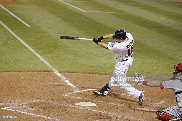 Jason Kubel of the Minnesota Twins hits a grand slam home run to complete the cycle in the eighth inning against the Los Angeles Angels at the...