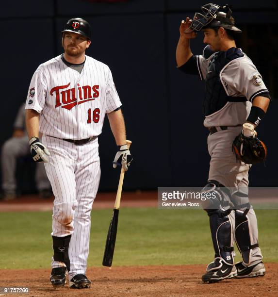 Jason Kubel of the Minnesota Twins walks away from home plate after being struck out in the ninth inning by New York Yankees closer Mariano Rivera in...