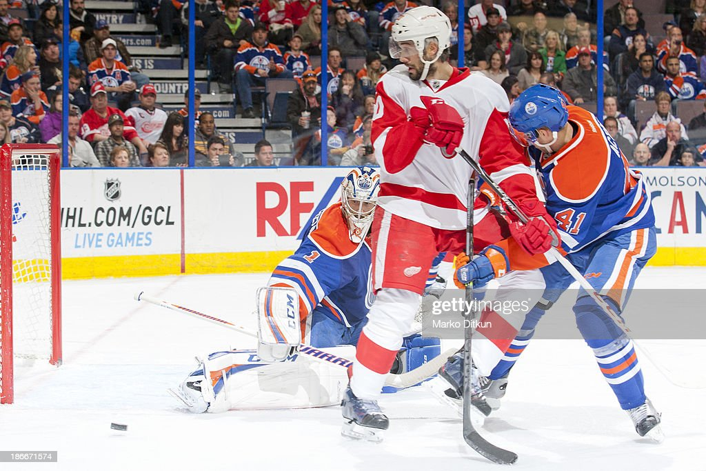 Jason LaBarbera #1 of the Edmonton Oilers makes a save in a game against the Detroit Red Wings on November 2, 2013 at Rexall Place in Edmonton, Alberta, Canada.