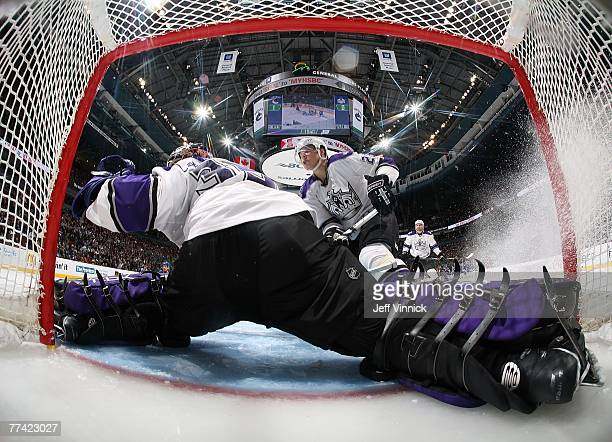 Jason LaBarbera of the Los Angeles Kings makes a save off a Vancouver Canuck shot as teammate Dustin Brown looks on during their game at General...