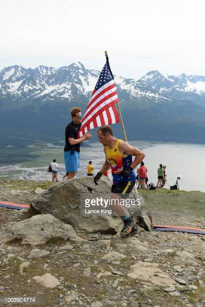 Jason Lamoreaux passes the top of Mount Marathon during the Men's Division of the 91st Running of the Mount Marathon Race on July 4 2018 in Seward...