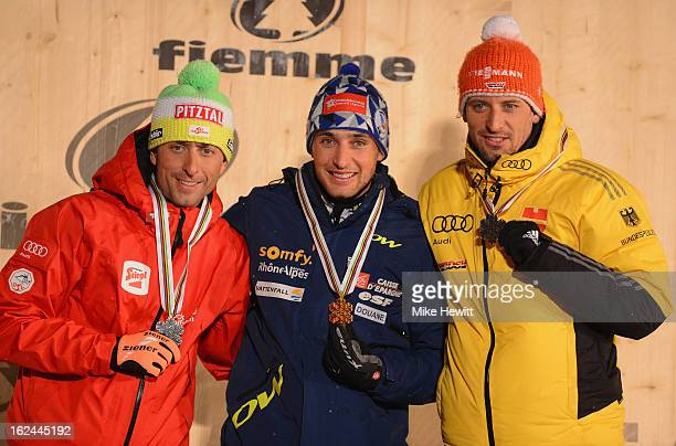 Jason Lamy Chappuis of France celebrates with his Gold medal Mario Stecher of Austria his Silver medal and Bjoern Kircheisen of German his Bronze...
