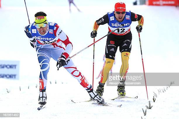 Jason Lamy Chappuis of France crosses the finish line ahead of Bjoern Kircheisen of Germany who wons the 3rd place of the Men's Nordic Combined on...