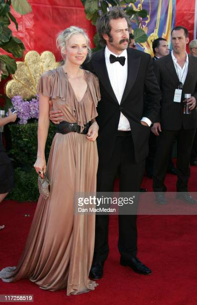 Jason Lee and Beth Riesgraf during 58th Annual Primetime Emmy Awards Arrivals at Shrine Auditorium in Los Angeles California United States